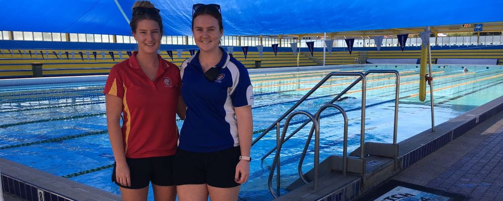 A fellow lifeguard with Verity Bignall standing by the pool at Bayswater Waves
