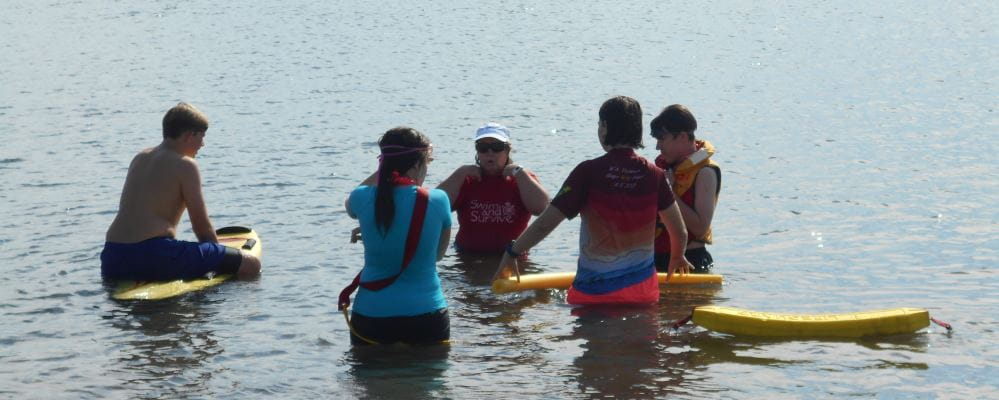 A small group of Sea Scouts learn water safety as part of the Bronze Medallion course