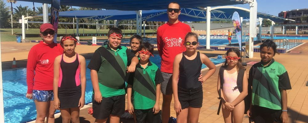group of children with two swim instructors at South Hedland swimming pool