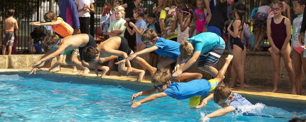 Children diving into the pool at Subiaco Primary School