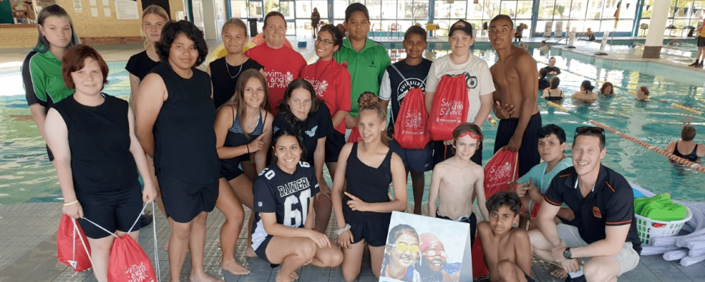 A group of Aboriginal youth wth their swim instructors and teachers by the pool at Swan Active Midland