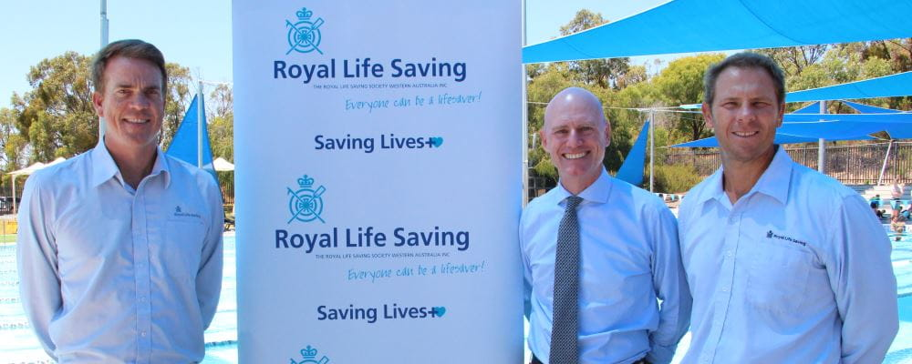 Royal Life Saving WA's Trent Hotchkin, Member for Churchlands Sean L'Estrange and Royal Life Saving WA CEO Peter Leaversuch in front of the pool at Bold Park Aquatic Centre