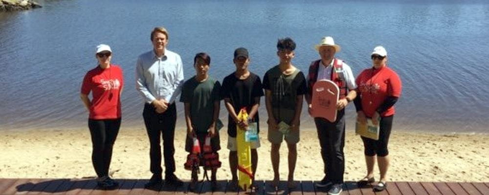 Swim instructors and multicultural participants with MP Steve Irons and RLSSWA's Trent Hotchkin by the Swan River