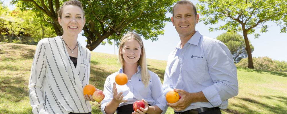 Minister Mia Davies, Scholarship winner Jessica Cruickshank and RLSSWA CEO Peter Leaversuch holding fruit