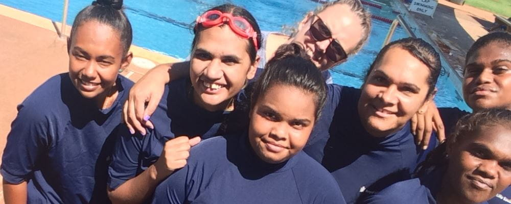 Students from Roebourne's Talent Pool program by the pool