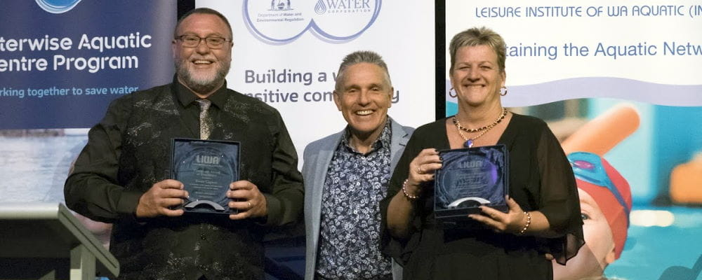 Trevor and Adele Caporn receiving their awards with LIWA President Jeff Fondacaro