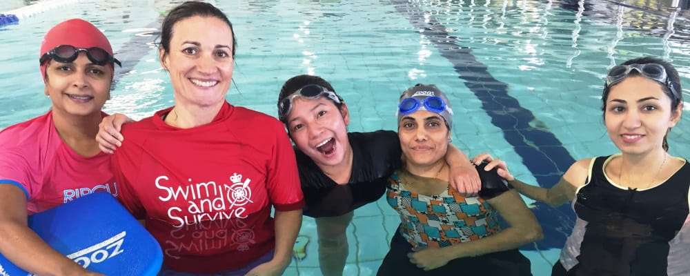 multicultural women with their instructor in the pool at Cannington