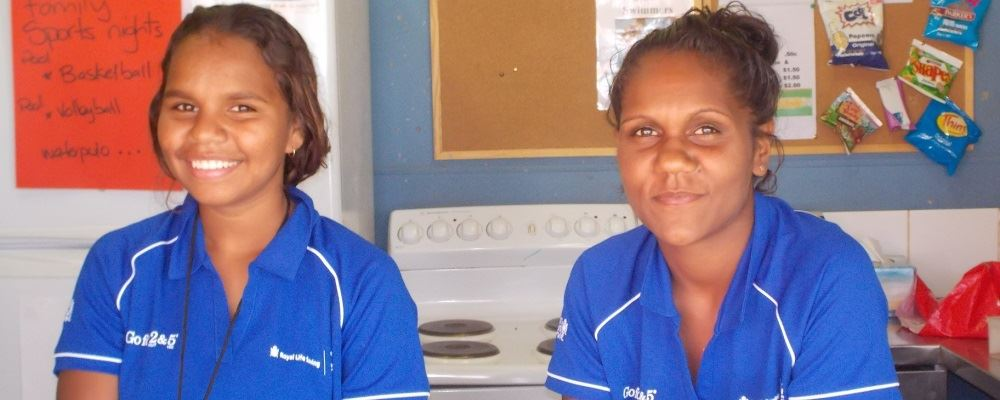 Jessica Gordon and Shonoah Coppin smiling at the camera while helping at the Yadeyarra Remote Aboriginal Swimming Pool