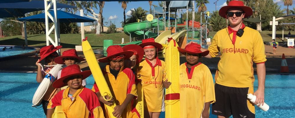 Port Hedland children dressed as lifeguards, with a South Hedland Aquatic centre lifeguard