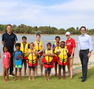 RLSSWA's Trent Hotchkin and Federal Member for Burt Matt Keogh with participants and their swim instructor at Champion Lakes