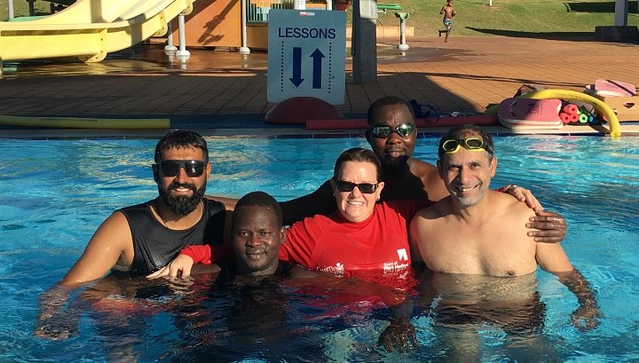 multicultural men in a pool after a swimming lesson