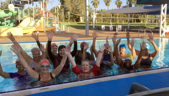Multicultural women in the pool with their swim instructor at Port Hedland