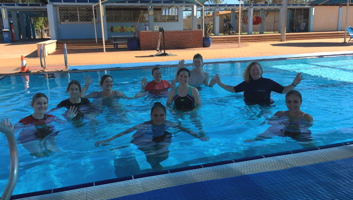 A group of swim instructor trainees in the pool with their teacher at Port Hedland