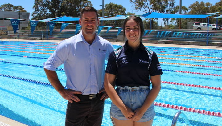 RLSSWA Senior Manager Workforce Solutions, Travis Doye, with Bree Bugeja by the pool at HBF Stadium