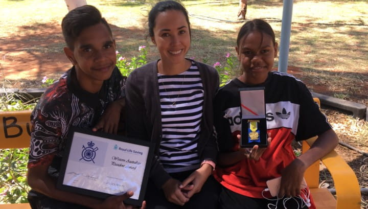 Jessica Albers (centre), with local students Imrahn and Zarhani and her Royal Life Saving President Award