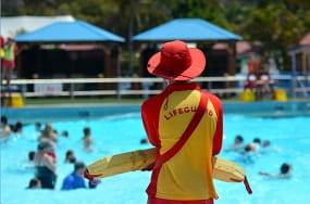 Lifeguard standing by a pool