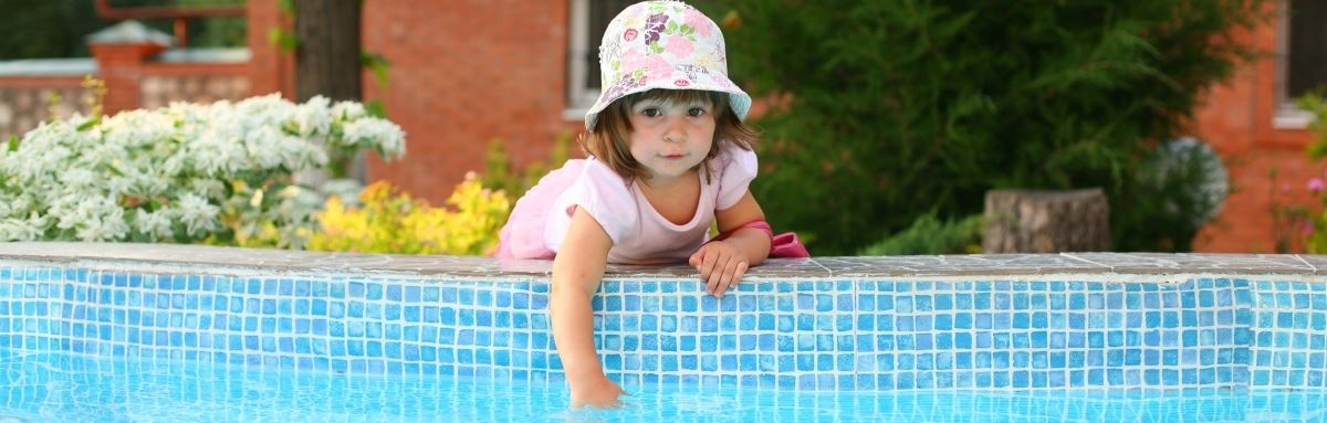Young child near a swimming pool