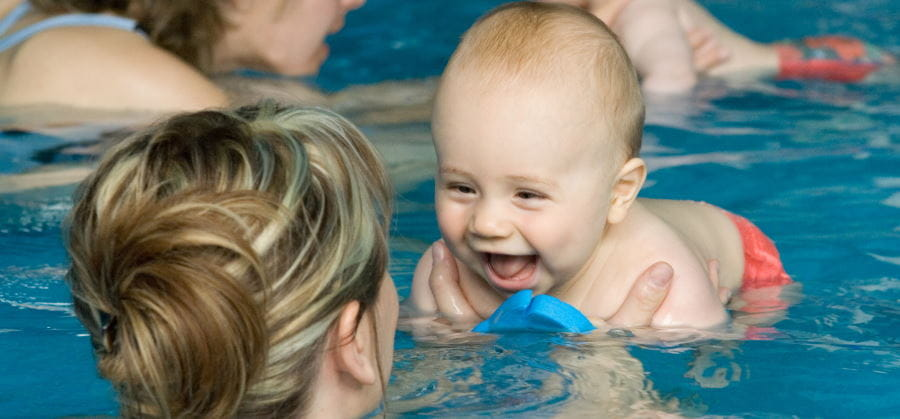 A baby with mum in a swimming pool