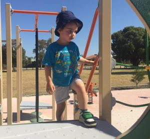 Lachlan playing at a playground