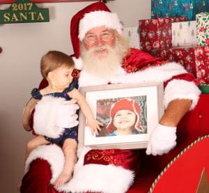 Baby Rosalie with Santa and a photo of big brother Lachlan