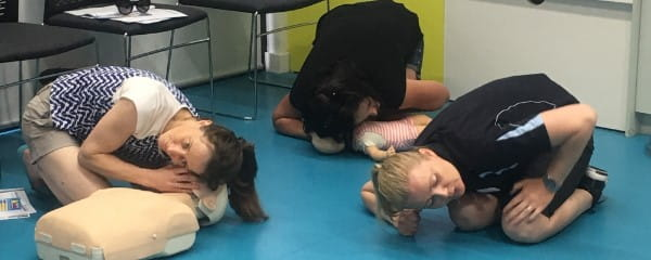Parents learning CPR