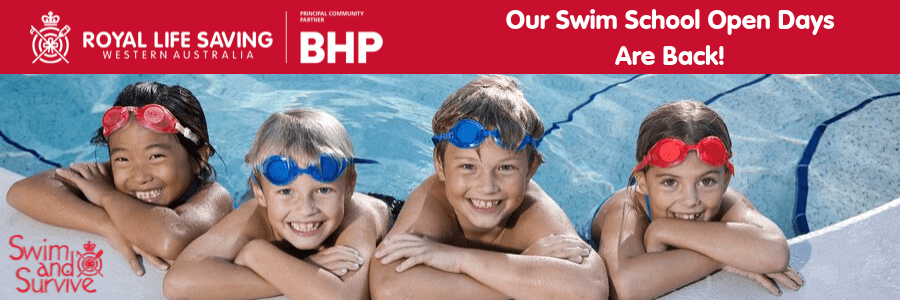 Four child along the edge of a pool with their arms resting on the side, smiling and wearing goggles