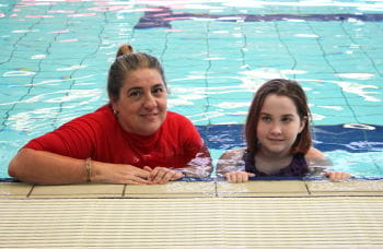 Sahara and her instructor in the pool