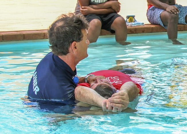 aquatic instructor demonstrating in pool