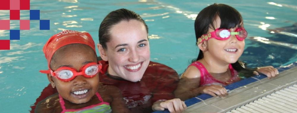 Swimming teacher with two children