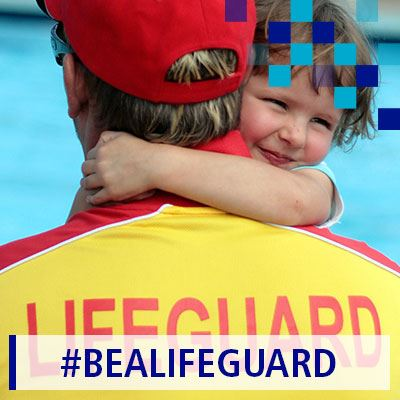 A lifeguard and a young child near a swimming pool