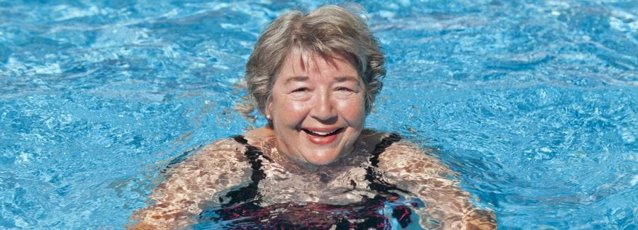 An older woman in the swimming pool