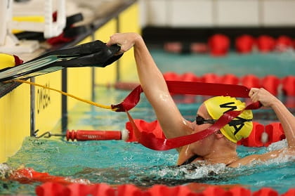 female pool lifesaving competitor in competition