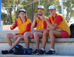 Image of 3 pool lifeguards sitting in the stands waiting for their events