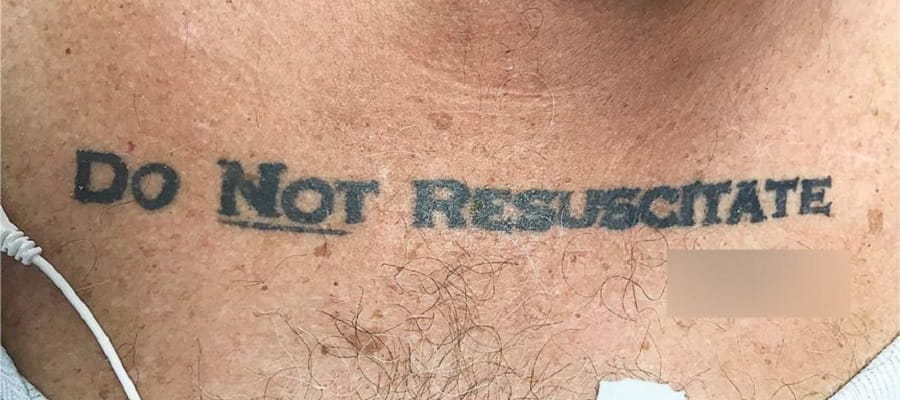 tattoo on man's chest reading Do Not Resuscitate